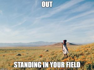 Picture of someone standing in a field.